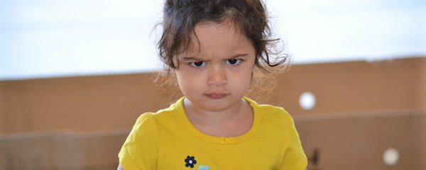 Young girl with ODD looks angrily at the viewer.